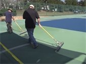 Men paving tennis courts
