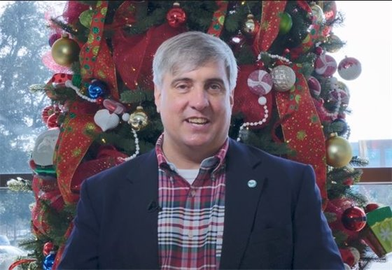 Mayor Grover Robinson in front of a Christmas Tree