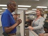 Robert Grier speaking with employee