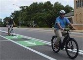 Mayor Grover Robinson riding a bike