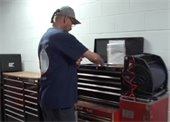 Karl Lewis looking over tools
