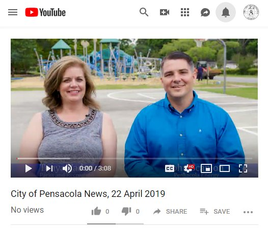 Screenshot of youtube channel showing Tonya and John sitting in front of playground