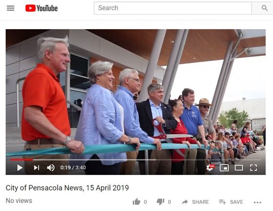 Screenshot of YouTube video of people cutting a ribbon