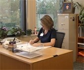 woman sits at her desk