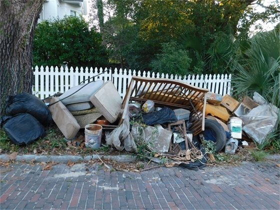 Pile of trash awaits to be picked up for neighborhood cleanup.