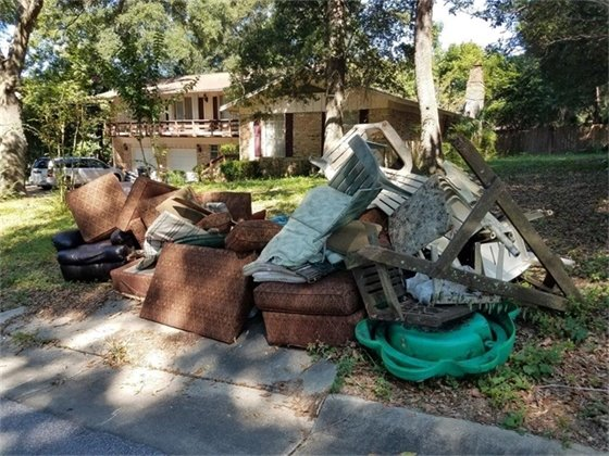 Furniture left at the curb for pickup by City of Pensacola Sanitation