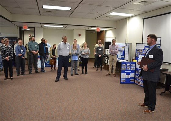 Public Works & Facilities Director Derrik Owens speaks at DEP's annual open house after receiving the environmental stewardship award.