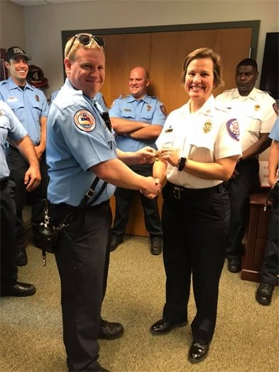 A photo of Chief Ginny Cranor with new Fire Captain Nicholas Dodds