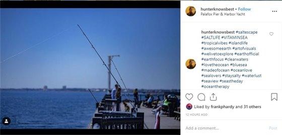 A photo of fishing poles at Palafox Pier