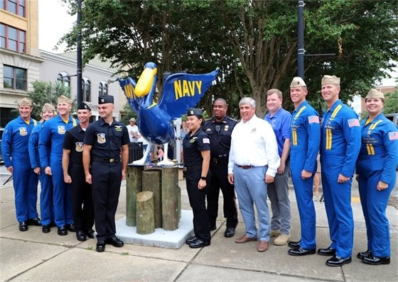 Mayor Robinson with the newly restored Navy pelican