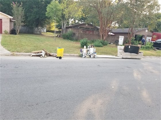 Garbage set curbside for collection