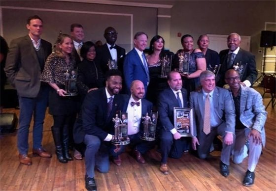 The Mayor is pictured with all the award winners and the host of the evening Commissioner Lumon May.
