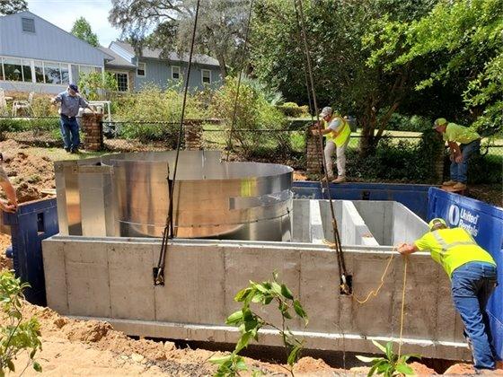 Crews install an underground stormwater treatment unit