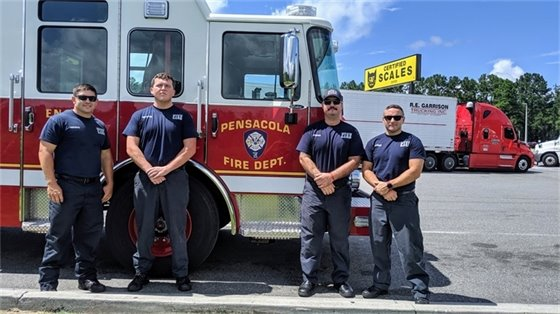 Pensacola firefighters in front of a fire truck