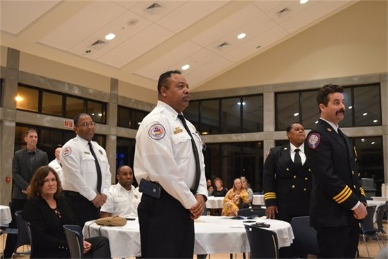 Firefighters stand to be recognized at the Pensacola Fire Department's annual awards ceremony