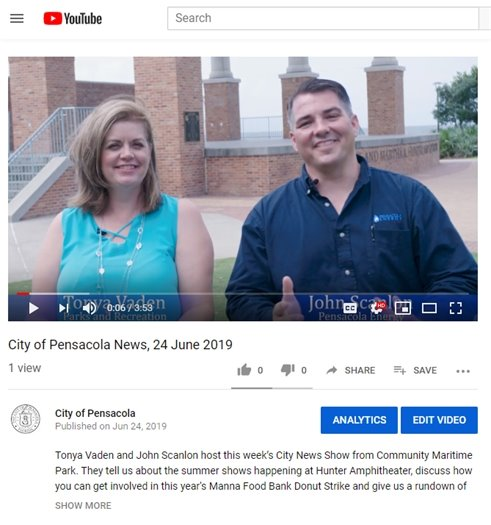 a screenshot of youtube with two people smiling at the camera