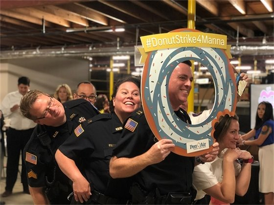 First responders from PPD and Pensacola Fire pose with the donut strike for manna donut
