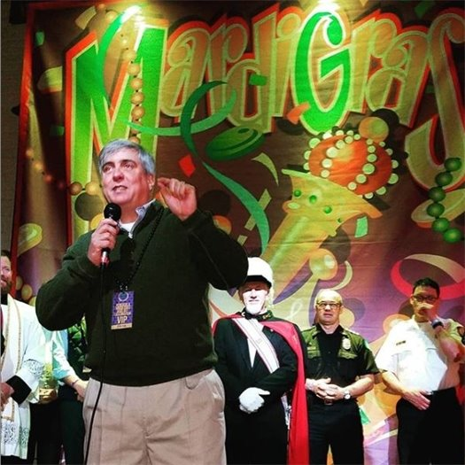 A photo of Mayor Robinson at a mardi gras party