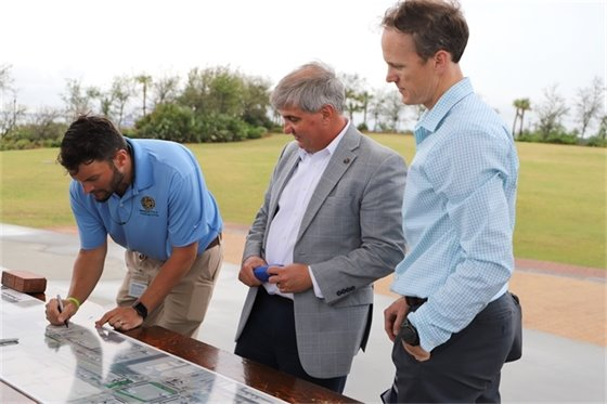 Capital Improvements Project Manager David Forte, Mayor Grover Robinson and Councilman Jared Moore view project plans at the Downtown Hashtag Connector Project Open House on Wednesday, April 14.