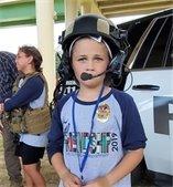 A Camp Friendship participant tries on a PPD helmet