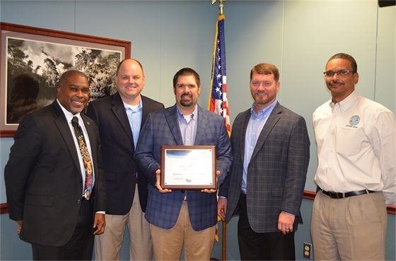 From left: Kerrith Fiddler, Assistant City Administrator; Brad Hinote, Engineering Project Manager; Chris Mauldin, Engineering Specialist; Derrik Owens, Public Works and Facilities Director; and Shawn Hamilton, Director of DEP's Northwest District