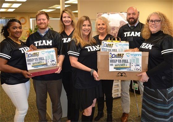 Planning services staff with fill the mayflower donations
