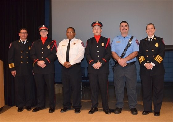 Firefighters pose for a photo at the Pensacola Fire Department's annual awards ceremony