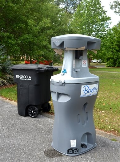 A portable handwashing station and city trash can