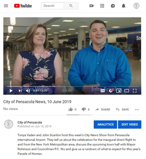A screenshot of YouTube showing two people smiling