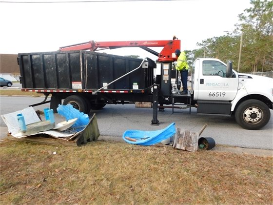 Image of sanitation vehicle picking up bulk waste.