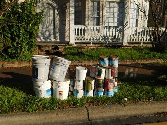 Gallons of paint await to be picked up for the neighborhood cleanup