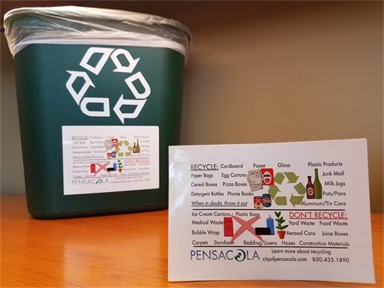 Photo of the recycling bin and sticker