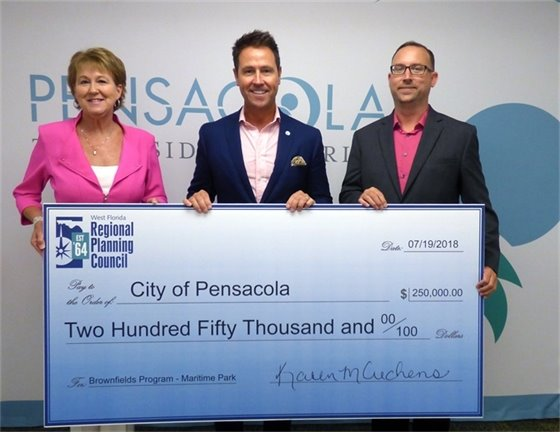 Mayor poses with check