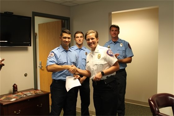 Photo of Fire Chief Ginny Cranor welcoming new firefighter