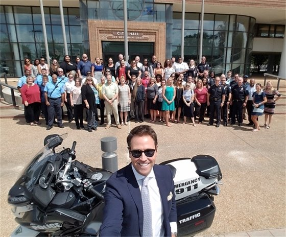 Mayor Ashton Hayward takes selfie with staff in front of Pensacola City Hall