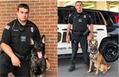 Photo of two officers with their K9 companions