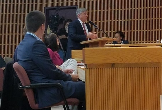 Mayor Robinson talks at a podium
