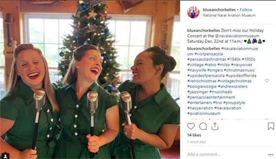 A photo of three women singing