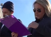 A woman looking at a clip board