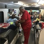 Two employees donating blood