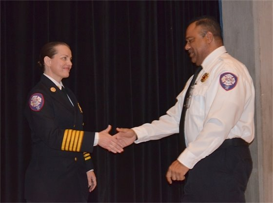 Chief Ginny Cranor shakes a firefighter's hand at the Pensacola Fire Department's annual awards ceremony