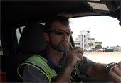 man talking into walkie talkie