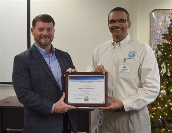 Derrik Owens, City of Pensacola Public Works & Facilities Director, and Shawn Hamilton, Director of DEP's Northwest District with the city's environmental stewardship award