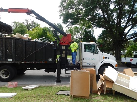 City Sanitation staff operating cleanup truck.