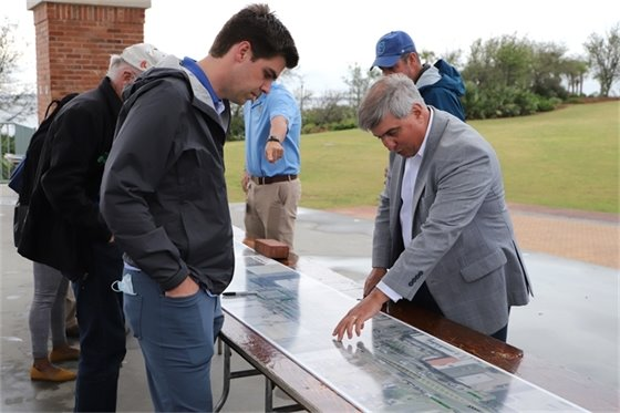 Mayor Grover Robinson views project plans at the Downtown Hashtag Connector Project Open House on Wednesday, April 14.