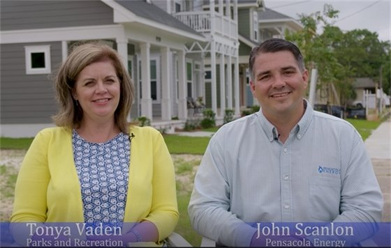 Tonya Vaden and John Scanlon in front of the homes at Garden District Cottages