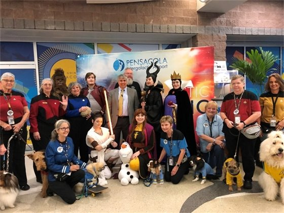 Mayor Grover Robinson with characters at Pensacola International Airport
