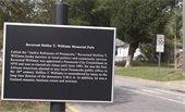 A memorial sign for a park
