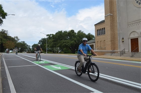 Mayor Grover Robinson rides his bike down the new bike lanes along Palafox Street