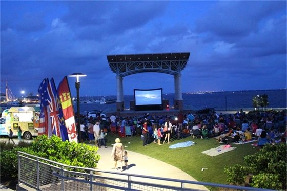 Crowds sit to enjoy the Hill-Kelly movies in the park series at community maritime park